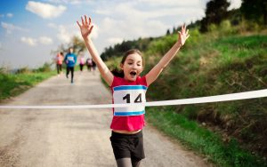 girl finishing road race