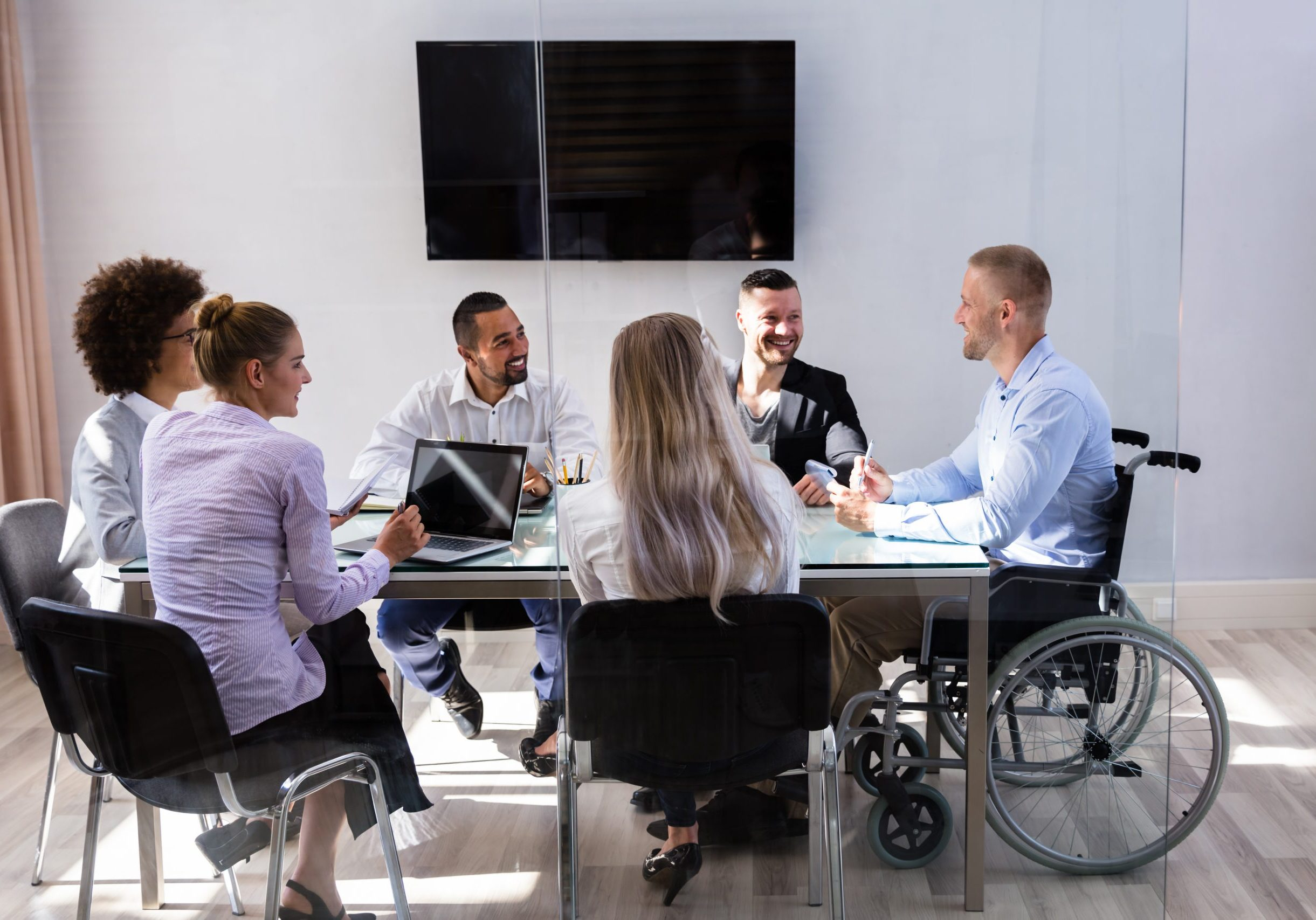 Disabled,Male,Manager,Sitting,With,His,Colleagues,At,Workplace